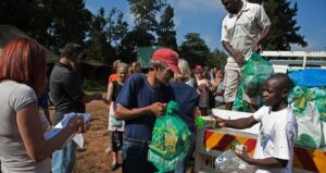 A man receives a monthly supply of food aid donated to residents of a squatter camp for poor white South Africans, at Coronation Park, in Krugersdorp, on March 6 2010. Photo©Finbarr O'Reilly/Reuters