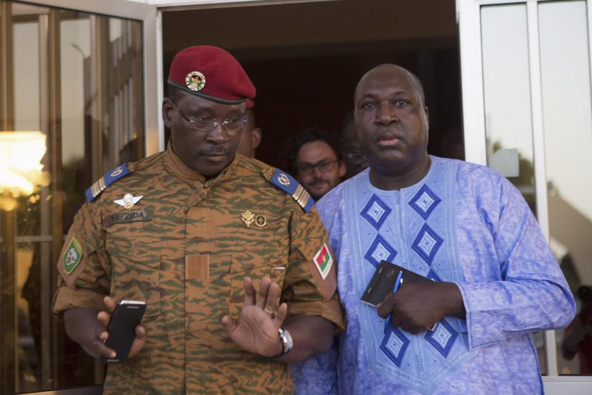 Lieutenant Colonel Yacouba Isaac Zida (L) meets with opposition leader Zephirin Diabre in Ouagadougou, capital of Burkina Faso, November 2, 2014. Burkina Faso's army cleared thousands of protesters from the capital and fired warning shots at state TV headquarters on Sunday as it sought to tighten its grip on power following the resignation of President Blaise Compaore two days ago. REUTERS/Joe Penney (BURKINA FASO - Tags: POLITICS CIVIL UNREST MILITARY)