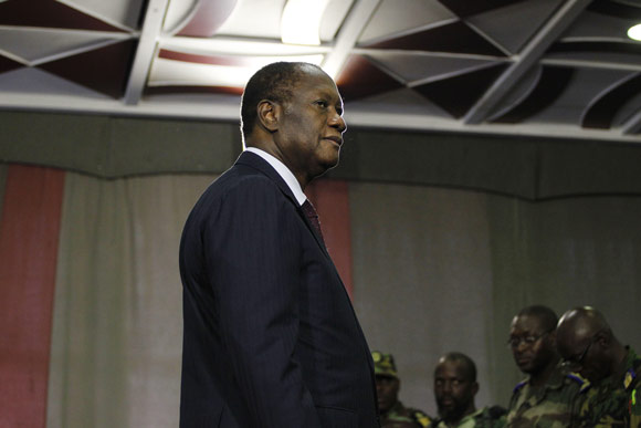 Ivory Coast President Alassane Ouattara meets with military commanders at the Golf Hotel in Abidjan during crisis that followed last elections