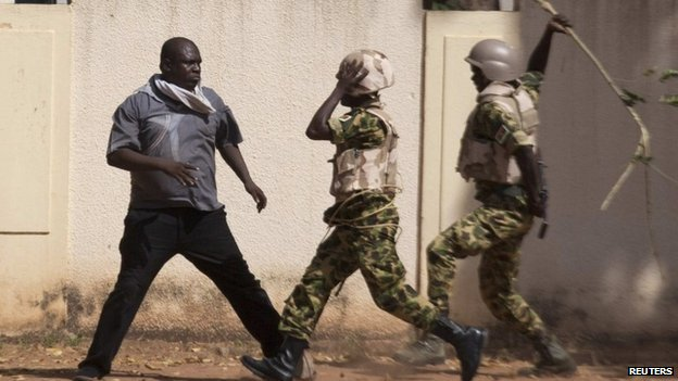 This photo of Lassina Sawadogo standing up to soldiers went viral