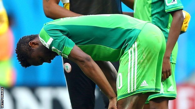 A dejected Mikel Obi Nigeria miss on the continents'biggest soccer tournament