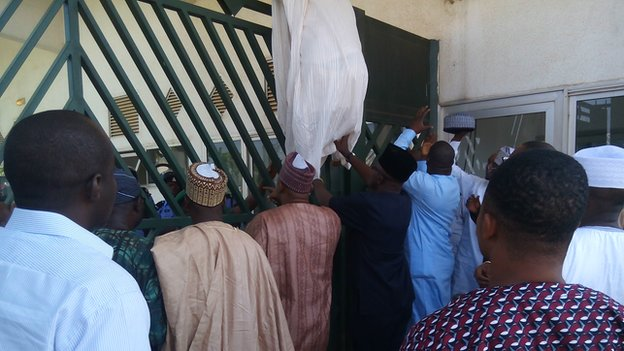 Politicians scaling the gates to enter parliament in a recent standoff with security forces to bar the Speaker of The House who defected from to the opposition from the building.