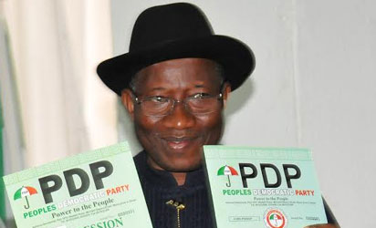 President Goodluck Jonathan displaying Expression of Interest and Nomination Forms at the People's Democratic Party's Secretariat in Abuja on Thursday (30/10/14).