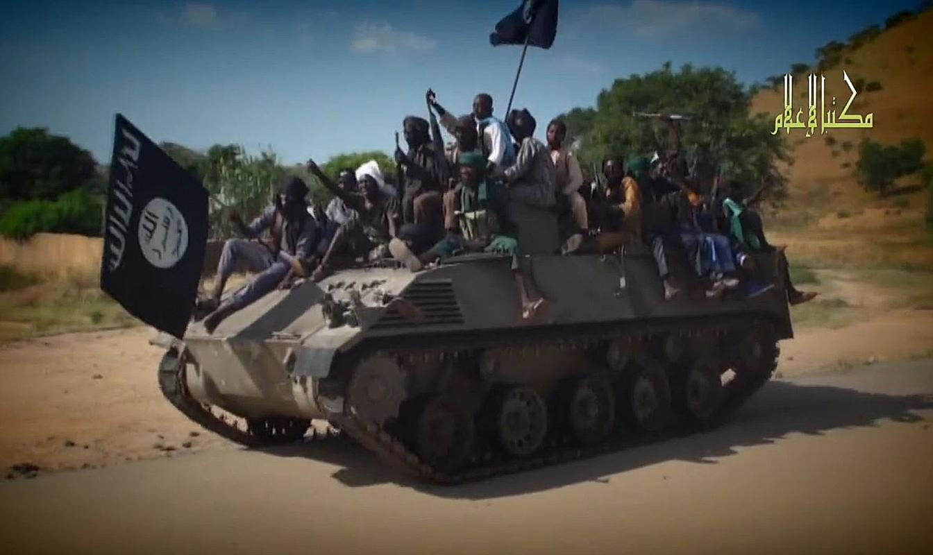 A screengrab taken on November 9, 2014 from a video released by Nigerian Islamist extremist group Boko Haram fighters parading on a tank in an unidentified town (AFP Photo/)