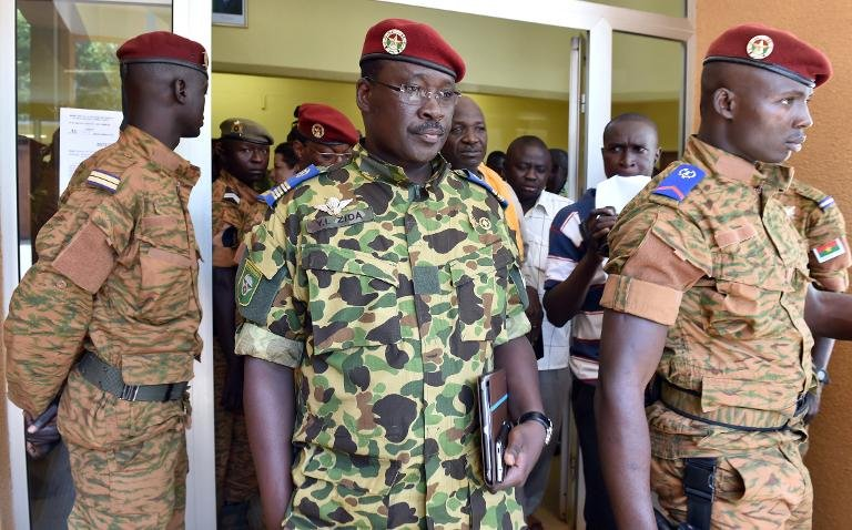 Burkina Faso's Lieutenant-Colonel Yacouba Isaac Zida (C) leaves after a meeting with the country's military commanders on November 1, 2014 in Ouagadougou