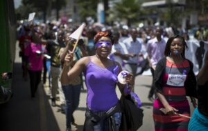 Kenyan women protest for the right to wear whichever clothes they want, at a demonstration in downtown Nairobi, Kenya Monday, Nov. 17, 2014. A recent incident in which a mob of men surrounded a woman and tore her clothes off, leaving her naked on the street in front of a bus stop after alleging that she was improperly dressed, is one of several such videos that have surfaced online in recent days leading to a groundswell of anger that on Monday prompted around 1000 demonstrators, including a number of men supporting the women's cause, to march through the capital and protest online using the hashtag #MyDressMyChoice. (AP Photo/Ben Curtis)
