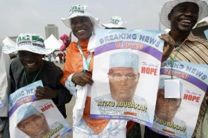 Supporters dance with posters of Nigerian Vice President Atiku Abubakar 20 December 2006 in Tafawa Balewa Square in Lagos, where the politician came to seek the presidential nomination on the platform of the opposition Action Congress (AFP Photo/Pius Utomi Ekpei)
