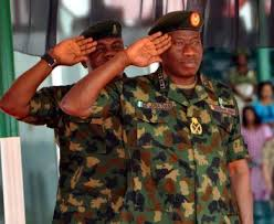 President Goodluck Jonathan in military gear .Is the surge of Boko Haram a sign of military weakness or unscrupulous politicians pulling strings?