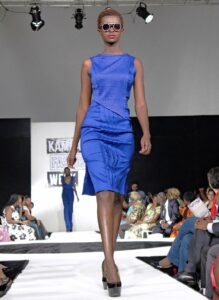 A model presents a creation by fashion designer Kwesh during the first fashion week show held in Kampala, on November 15, 2014 (AFP Photo/Amy Fallon)