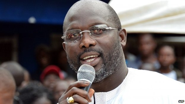 Liberian politician and ex-footballer George Weah speaks during a meeting for the opening of political campaign activities for senatorial elections on November 14, 2014 in Monrovia ©Zoom Dosso (AFP/File)