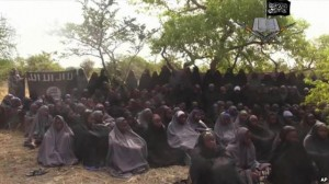FILE- In this Monday, May.12, 2014 file image taken from video by Nigeria's Boko Haram terrorist network, shows the alleged missing girls abducted from the northeastern town of Chibok