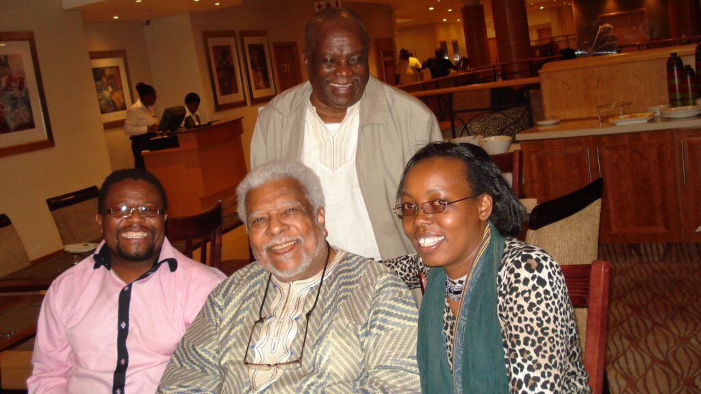 From right seated Esther Githinji, Professor Ali Mazrui & Professor James Kariuki standing