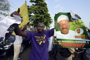 A party supporter holds a poster of the opposition All Progressives Congress presidential aspirant Mohammadu Buhari, at the party's presidential primary in Lagos on December 11, 2014 (AFP Photo/Pius Utomi Ekpei)
