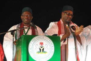 Nigeria's president Goodluck Jonathan (L) delivers a speech next to PDP National Chairman Adamu Muazu, after winning a presidential primary in Abuja, on December 11, 2014 (AFP Photo/Olamikan Gbemiga)