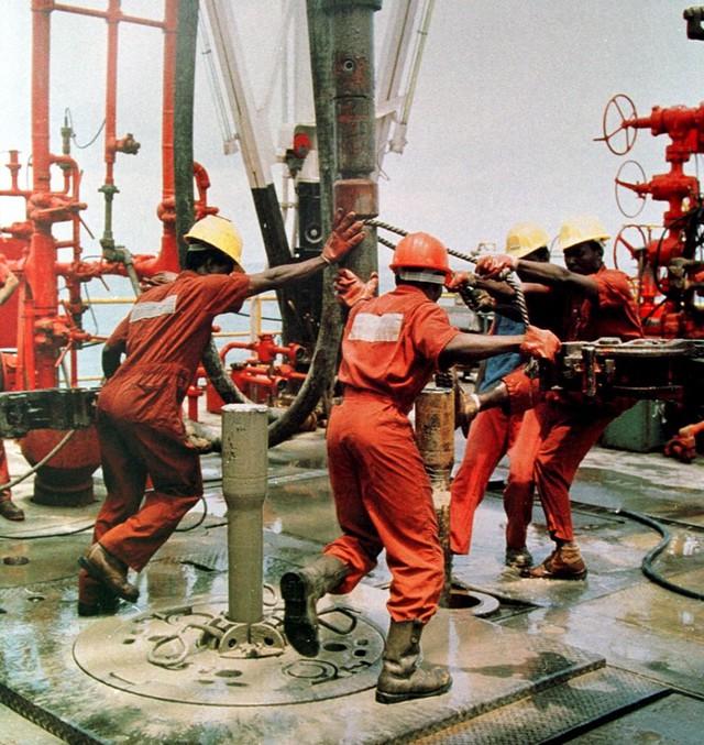 Men work on an oil rig in Nigeria. Photographer: Stringer/AFP via Getty Images