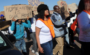 Photo: Werner Beukes/Sapa Protesters demonstrate during a march to the home affairs department against revised immigration regulations in Johannesburg on Wednesday, 25 June 2014