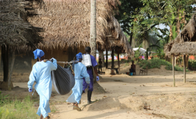 Photo: United Nations World Food Programme MSF health team in the village carrying a suspected Ebola patient.