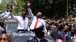 Cheering crowds welcome Kenyatta on return from The Hague