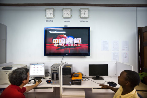 Chinese and Kenyan employees of the Xinhua news agency watching a CCTV news program in Xinhua's Nairobi bureau.Credit Sven Torfinn for The New York Times