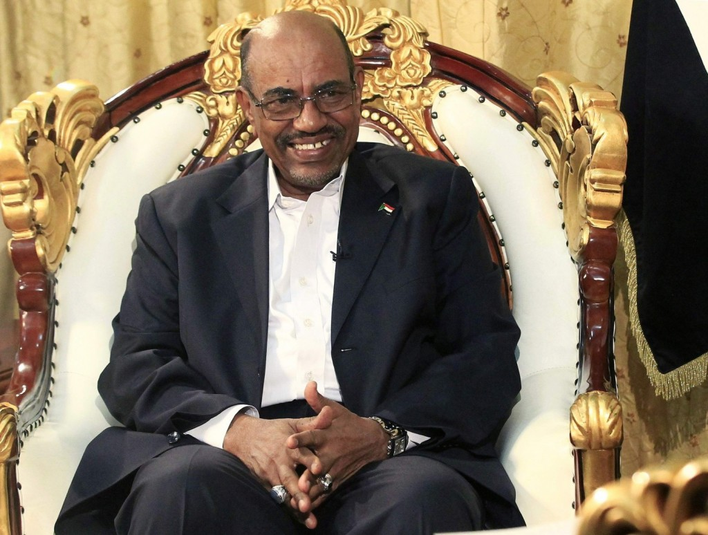 Sudan's President Omar al-Bashir smiles during an interview with the Russia Today news channel at the Presidential Palace in Khartoum, December 3, 2014. (Mohamed Nureldin Abdallah/Reuters)