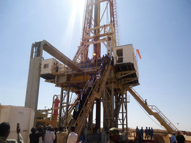 Engineers and visitors explore an exploratory well near Dharoor town, 350 km (217 miles) from the port of Bosasso on the Gulf of Aden in Puntland, January 17, 2012. (Abdiqani Hassan /Courtesy Reuters)
