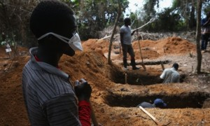 Grave diggers prepare for new Ebola victims outside an Ebola treatment centre near Gbarnga, central Liberia. Photograph: John Moore/Getty Images