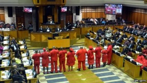 Members of the EFF in their red workers uniforms are sworn into parliament