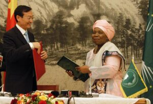 The chairperson of the African Union Commission, Nkosazana Dlamini Zuma (R), and Chinese Vice Foreign Minister Zhang Ming exchange memorandums of understanding on January 27, 2015, on a continent-wide infrastructure deal in Addis Ababa, Ethiopia (AFP Photo/Elias Asmare)