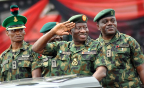 Photo: Vanguard President Goodluck Jonathan (centre) inspecting parade during the Nigerian Army Day Celebration in Abuja (file photo).