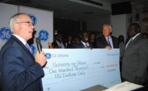 Photo: University of Ghana Vice-Chancellor Prof. Ernest Aryeetey (right), receiving the symbolic cheque on behalf of the University. With him are Mr. Jeff Immelt, Global Chairman of GE (second from right) and Hon. Emmanuel Kofi Buah, Minister of Energy and Petroleum (third from right)