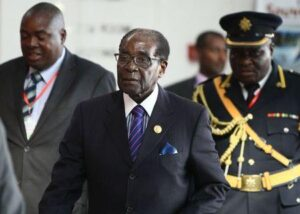 Zimbabwe's President Robert Mugabe (C) arrives for the 24th Ordinary session of the Assembly of Heads of State and Government of the African Union (AU) at the African Union headquarters in Ethiopia's capital Addis Ababa, January 31, 2015. REUTERS/Tiksa Negeri