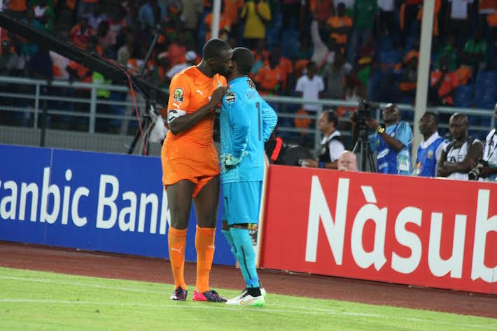 Ivory Coast's Yata Touré kisses his team mate and goal keeper, Boubacar Barry. Photo©Taimour Lay