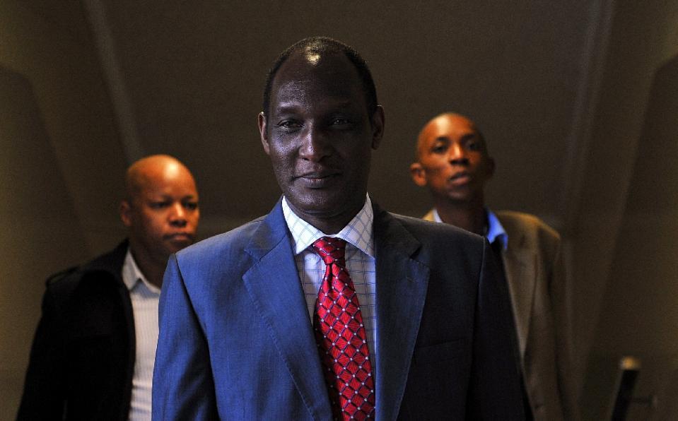 Rwanda's former army chief Faustin Kayumba Nyamwasa walks into court in Johannesburg, South Africa, on June 21, 2012 (AFP Photo/Alexander Joe)