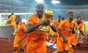 Ivory Coast's Kolo Touré raises the trophy after the final. Photograph: Carl De Souza/AFP/Getty Images