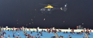 A police helicopter caused a commotion inside the stadium as it sprayed around debris