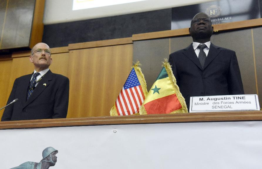US Ambassador to Senegal James Peter Zumwalt (L) and Senegalese Defense Minister Augustin Tine attend the opening of the African Land Forces summit on February 9, 2015 (AFP Photo/Seyllou