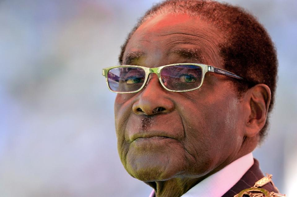 Zimbabwean President Robert Mugabe attends his inauguration and swearing-in ceremony at the sports stadium in Harare on August 22, 2013 (AFP Photo/Alexander Joe)