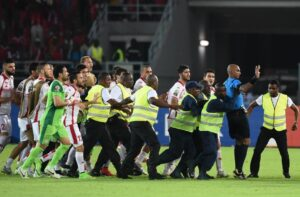 Security guards protect referee Rajindraparsad Seechurn (2nd-R) from Tunisia's players at the end of the 2015 African Cup of Nations quarter-final football match between Equatorial Guinea and Tunisia in Bata on January 31, 2015 (AFP Photo/Carl De Souza)