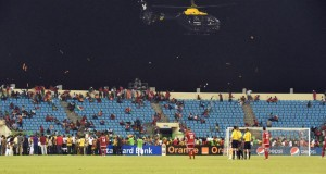 A police helicopter flies over the stadium during an interruption of the 2015 African Cup of Nations semi-final (AFP Photo/Issouf Sanogo)