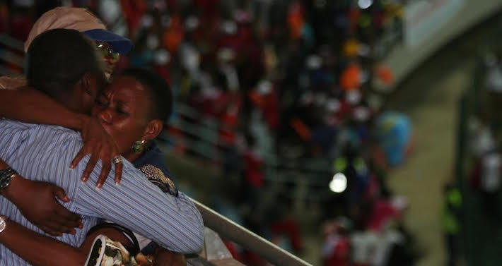 DRC fans celebrate in the upper tier of the stand after witnessing their team's fourth goal. Photo©Taimour Lay