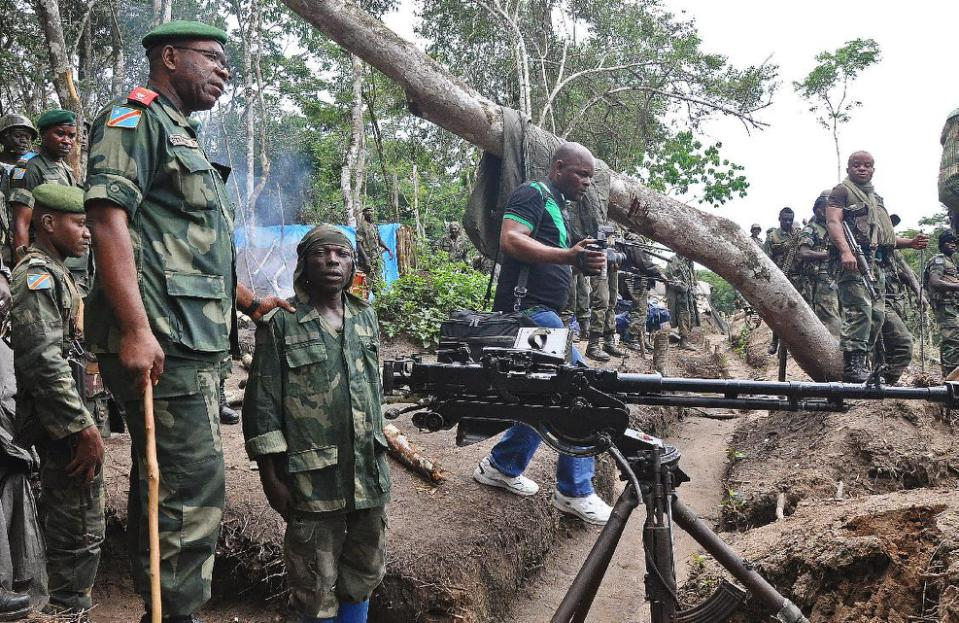 Lieutenant General Didier Etumba Longila (left), chief of the general staff of DR Congo armed forces, meets soldiers in Beni in North Kivu, in May last year (AFP Photo/)