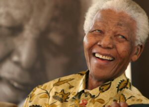 "FILE- In this Dec. 7, 2005 file photo, former South African President, Nelson Mandela, smiles at the Mandela Foundation in Johannesburg. The former political prisoner who became the country's first black president in 1994 died in December 2013 at the age of 95. Pan Macmillan said Tuesday, March 24, 2015, that it will publish the sequel to Mandela's best-selling autobiography ""Long Walk to Freedom"" in Britain, South Africa, India and Australasia in 2016. U.S. and Canadian rights have not yet been sold. (AP Photo/Denis Farrell)"