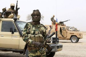 A Chadian soldier poses for a picture at the front line during battle against insurgent group Boko Haram in Gambaru, February 26, 2015. REUTERS/Emmanuel Braun