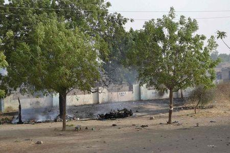 A burnt motorcycle is seen after Chadian forces took control from Boko Haram insurgents in Dikwa March 2, 2015. REUTERS/Madjiasra Nako