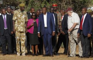 "Kenya's President Uhuru Kenyatta (C) looks on as 15 tonnes of ivory confiscated from smugglers and poachers is burnt to mark the World Wildlife Day at the Nairobi National Park March 3, 2015. The United Nations on December 20, 2013, declared 3rd March World Wildlife Day as a celebration of wild fauna and flora and to raise awareness of illegal trade. The 2015 theme for World Wildlife Day is ""Wildlife Crime is serious; let's get serious about wildlife crime"". REUTERS/Thomas Mukoya (KENYA - Tags: SOCIETY CRIME LAW POLITICS ANNIVERSARY ENVIRONMENT ANIMALS)"