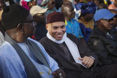 Karim Wade (C), son of Senegal's former president Abdoulaye Wade, attends a rally by his father's political party Parti Democratique Senegalais (PDS) in Dakar December 6, 2012. REUTERS/Joe Penney