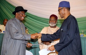 Nigerian President Goodluck Jonathan (left) and APC main opposition party presidential candidate Mohammadu Buhari shake hands on March 26, 2015 in Abuja Security is a major concern at Saturday's vote both from Boko Haram violence against voters and polling stations to clashes between rival supporters. In 2011, around 1,000 people were killed in violence after Jonathan beat Buhari to the presidency. AFP PHOTO / PHILIP OJISUA (AFP Photo/Philip Ojisua)