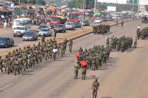 Photo: Ikechukwu Ibe/IRIN Nigerian troops on the streets of Abuja in a show of force on Thursday