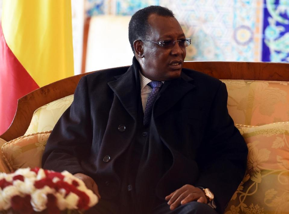 he President of Chad Idriss Deby Itno sits upon his arrival at Houari Boumediene Airport, outside Algiers, on December 27, 2014 (AFP Photo/Farouk Batiche)