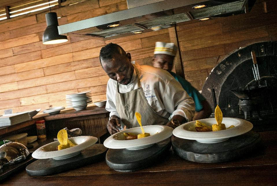 Chef Christian Yumbi has struggled against racism and the economic crisis in Belgium, but is finding the fame and fortune he hoped for back in DR Congo (AFP Photo/Federico Scoppa)